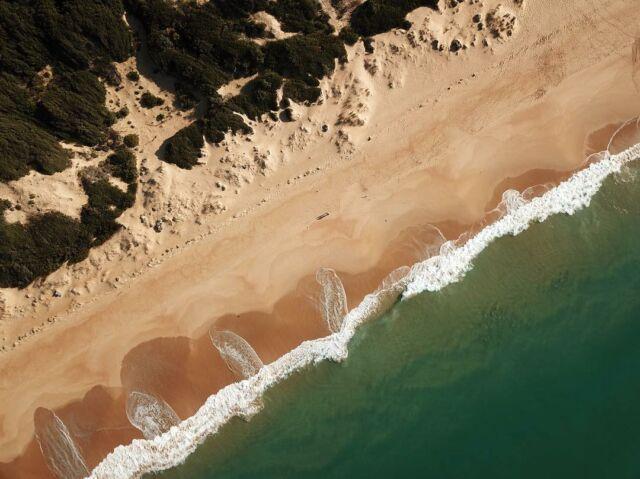 The relentless ocean rolls against the sandy shores; never sleeping. #beach