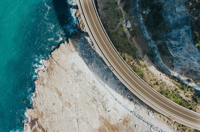 A perfect man made curve intersects the jagged coastline #coast